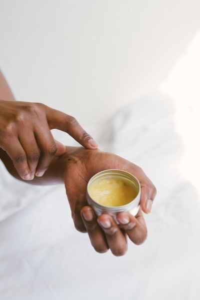 person holding a hand cream